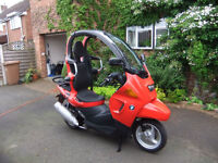 Base model BMW C1 for sale. Red. Low miles. Carefully maintained.