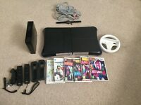 Black Nintendo Wii Fit Plus with Fit Board as Games