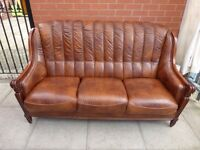 A Brown Leather Italian Three Seater Sofa