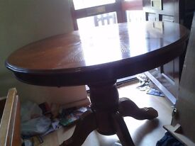 Round dining table,solid oak,carved leg,105cm,adjust screw,extension part missing