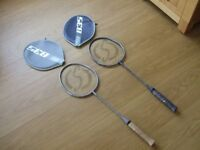 2 Olympus Sport 835 Racquets, 1 grey and 1 black.