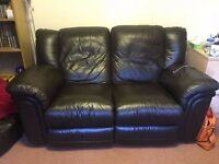 Dark brown leather effect 2-seater sofa recliner, £60.