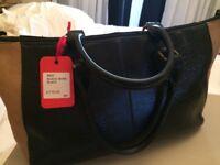 GIGI Black/Bone medium sized black leather handbag. Perfect condition