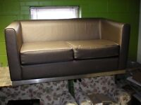 Brown two-seater sofa