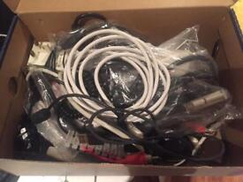 Shoebox of various cables