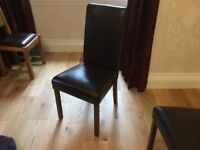 Set of 8 faux-leather dining room chairs