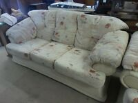 flowery beige sofa with matching chair