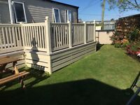 Luxury caravan at Seawick holiday park with private garden