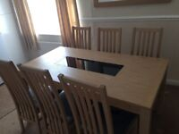 Dining room table with six chairs..