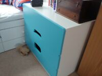 White chest of drawers with blue drawer fronts