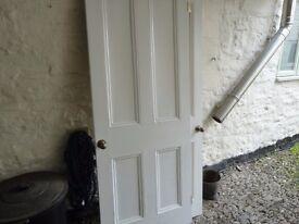 Two pine four paneled Victorian internal doors