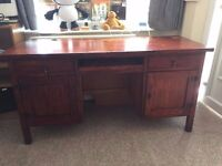 Solid wood desk with two top draws, cupboard and one large draw. Open to Offers