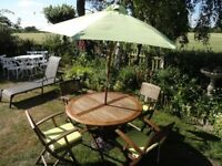 SOLID TEAK GARDEN SET --TABLE + 4 CARVER CHAIRS--CUSHIONS --PARASOL AND BASE --LARGE SIZE --