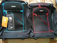 Set of two new hand luggage size suitcases