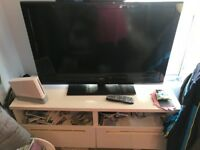 40 inch Bush (non smart) flat screen LCD TV and it's white wood TV stand
