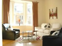 Bright modern 1 bed furnished flat with private parking.