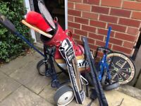 Golf Bag & Trolly with Childs trolly, various clubs, cricket bats, tennis rackets