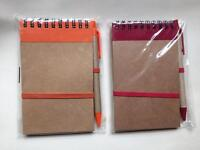Brand new cellophane wrapped notebooks with matching pens