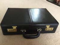 Black leather briefcase with address file and document clipboard