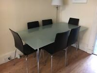 Lovely glass table with 6 chairs