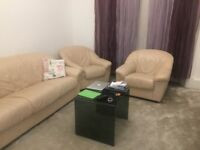 Beige Leather three seater and one seater sofa