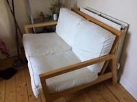 IKEA couch with white cushions.