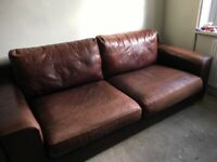 Beautiful chestnut leather sofa and chair