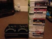 Xbox 360 32 games, racing wheel and Kinect