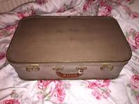 Vintage suitcase with striped lining