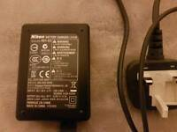 Nikon battery charger, model MH-65