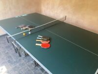 Table tennis table with bats and balls