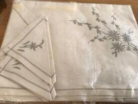 Vintage two sets of pure Irish linen embroidered tablecloths with napkins .