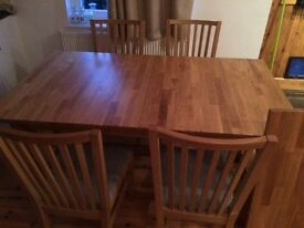 Solid wood dining room table and 6 chairs with extension only two years old
