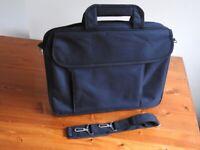 Slim padded black laptop carrying bag with detachable shoulder strap