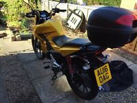 Honda CB125 2016 new in May. Yellow beautiful condition 2100 miles + top box and original rear bar