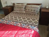 Solid wood king size bed with mattress and bedside cabinets