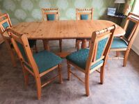 large family extending dining table with 6 chairs
