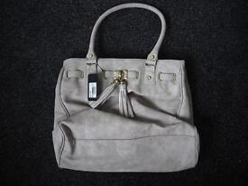 Brand new with tags tassel front grey/beige handbag
