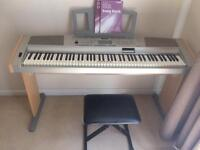 Yamaha Portable Grand keyboard and stool DGX-500