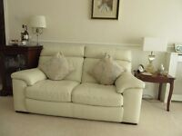 Contempo italian leather 2 seater sofa in good condition,in light cream colour