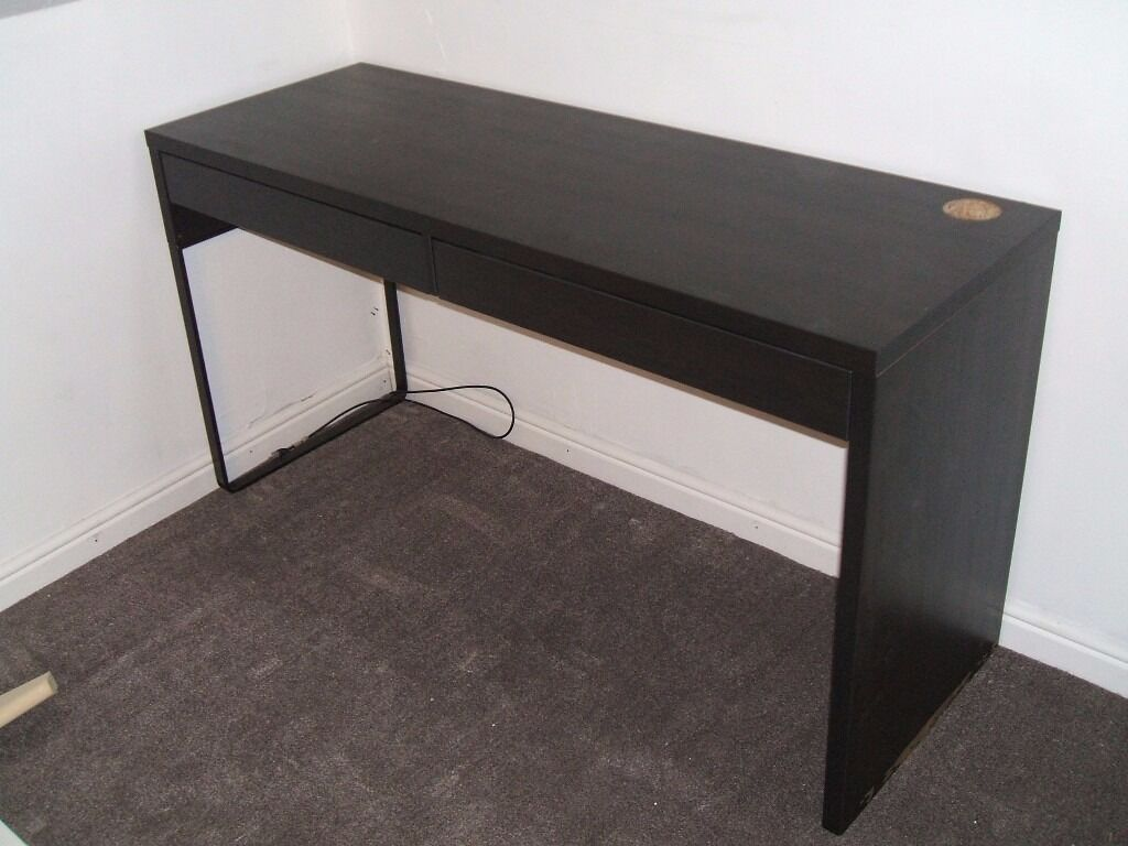 Ikea MICKE desk. Black/brown. Two drawers. 142x50cm. Excellent conditionin Milngavie, GlasgowGumtree - Ikea MICKE desk. Black/brown. Two drawers. 142x50cm. Excellent condition. I have 3 of these for sale 2 single drawer and this two drawer version. See my other ad. Make me an offer if you want all 3. From a smoke and pet free home
