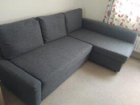 Corner sofa-bed with storage FRIHETEN