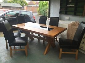 Solid oak dining table, very nice condition, cost new £1100 with 6 chairs