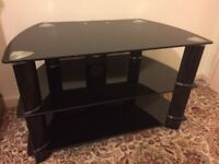 Black glass TV stand in excellent condition