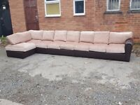Amazing BRAND NEW very very large brown leather base,beige fabric corner sofa. Can deliver