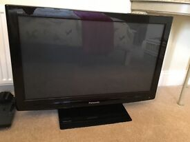 Panasonic Viera flatscreen TV with a combined video recorder and DVD player.