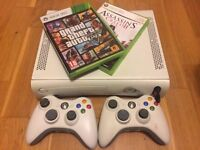 Xbox 360 plus GTA 5 and Assassin's Creed 2