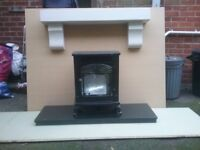 Log effect electric fire with pine painted mantel and black granite hearth