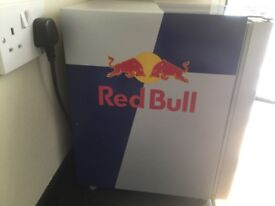 Red bull counter top fridge with lights in door