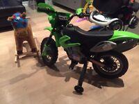 Boy sit on motor bike